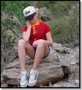 Stay Put!  Thinking through S.T.O.P. Note bright bandanna and whistle around her neck.