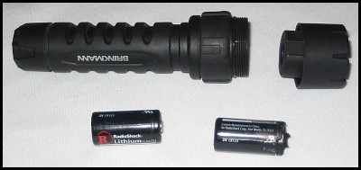 Exploded Lithium 123 Batteries and Brinkman Flashlight