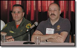 George Kleinbaum, Oregon SAR Coordinator (right), answers a question as Lt. Dan Patch, Vermont State Police (left), waits his turn to comment.