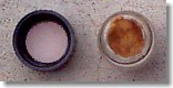 Cap w/ Teflon seal (L) and cotton in vial (R) (stained brown from iodine)